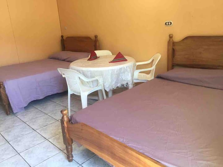 Convenient Coco Beach room with Queen beds and AC