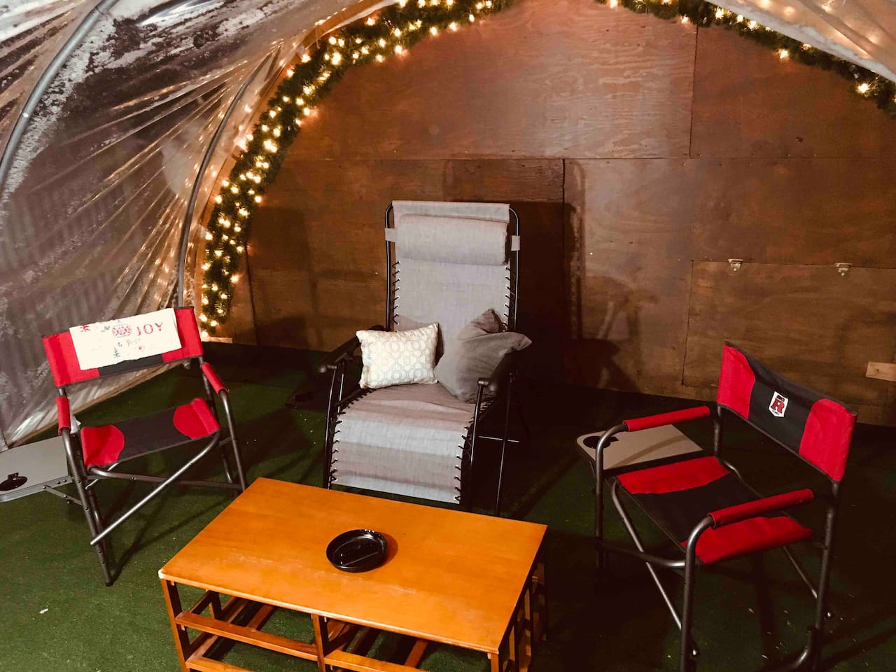 This is the new Green Room where guests can sit and relax out of the weather and smoke/drink/visit/relax in a private covered room (rules apply).