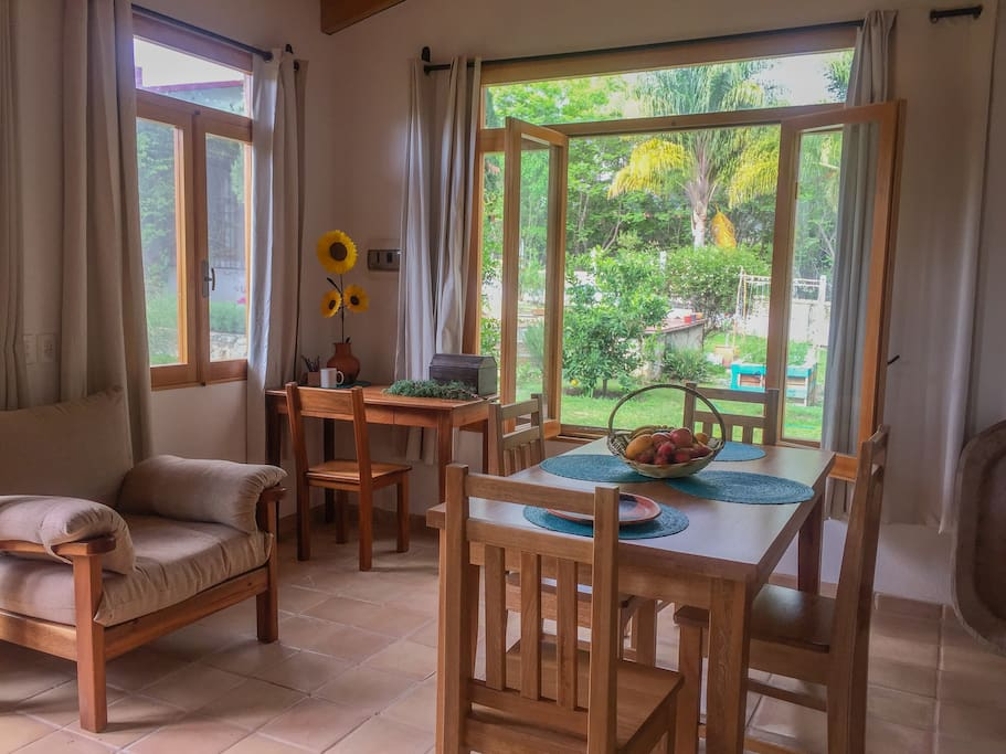 The little yellow bungalow is a peaceful, airy studio with big windows that make you feel like you're in the garden itself.