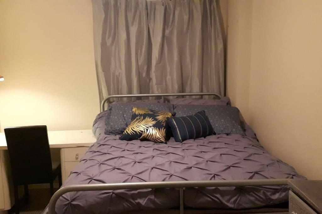 bedroom with dresser and desk