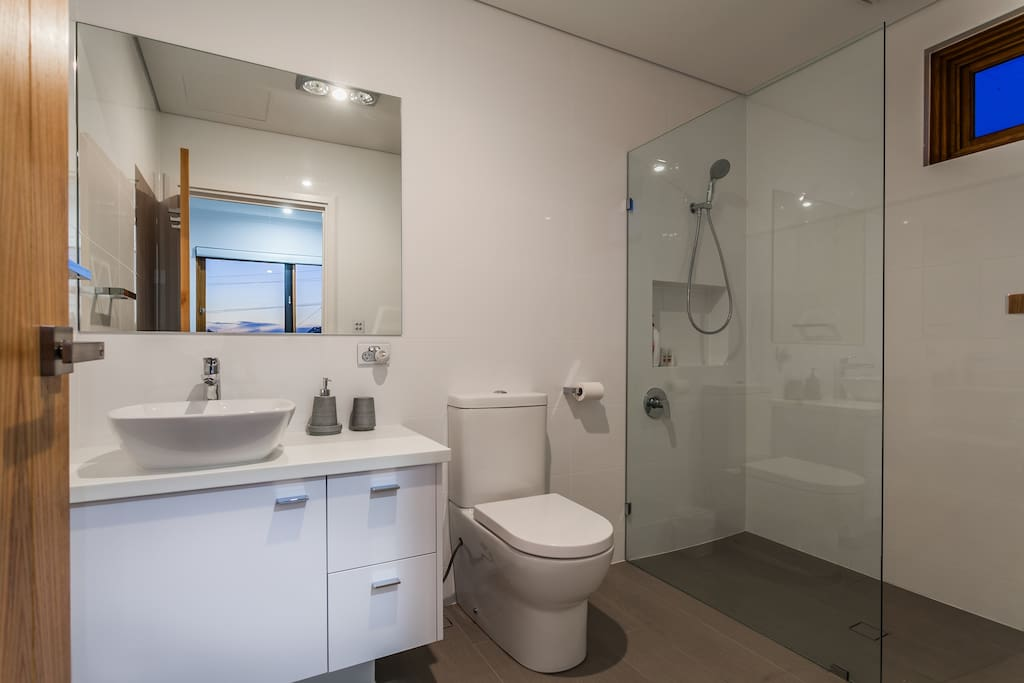 En-suite ( Attached bath & toilet) with complimentary towels, shower gel, shampoo & conditioner