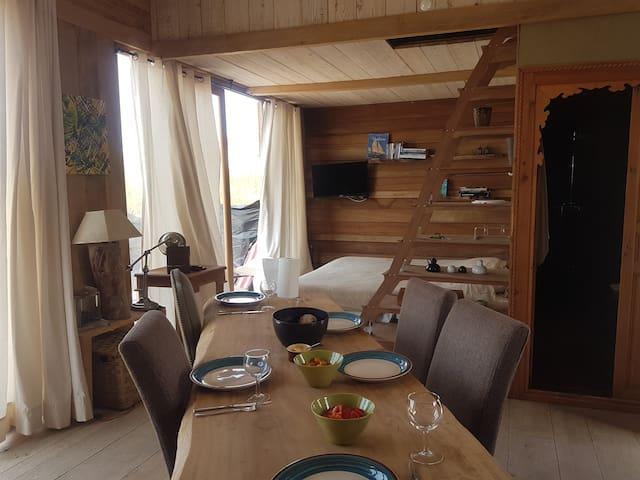 Maison en bois avec une vue inégalée sur le baie