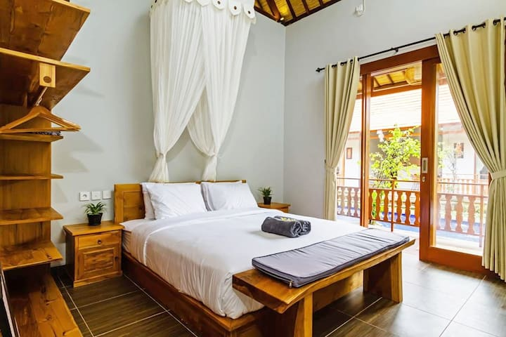 Spacious bedrooms with  comfortable King size bed, mosquito net, hanging wardrobe space & ensuite.