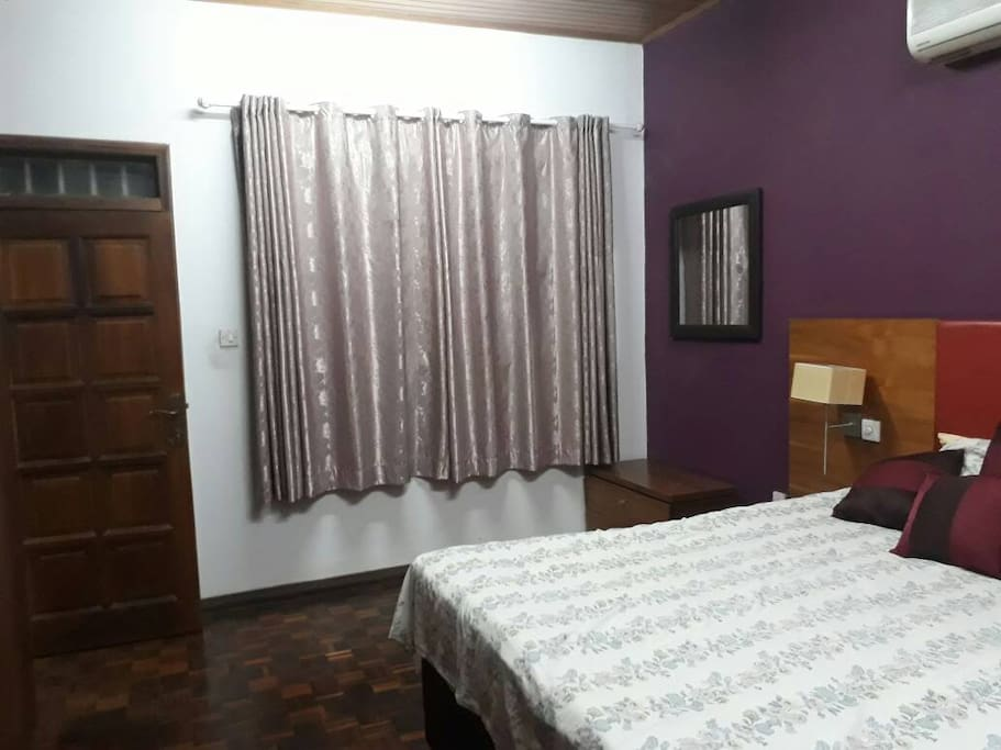 Large windows, door entry, bedside lamps and air conditioning