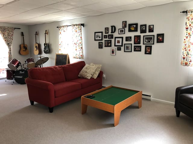 Large playroom in lower level also provides additional sleeping for one on sofa. There is a half bathroom located on this floor as well.
