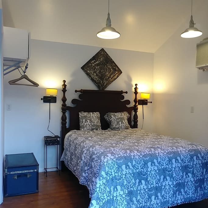 Comfy Queen Size Bed facing French doors and pool