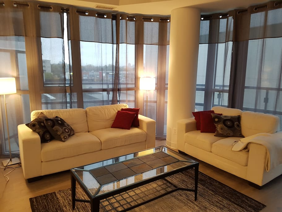 Inviting Living Room Area Overlooking Shops At Don Mills
