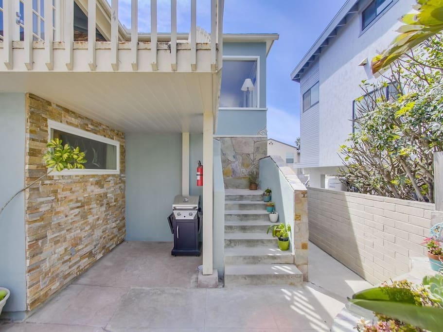 Stairs go up to the front door entrance and additional patio, great for grilling
