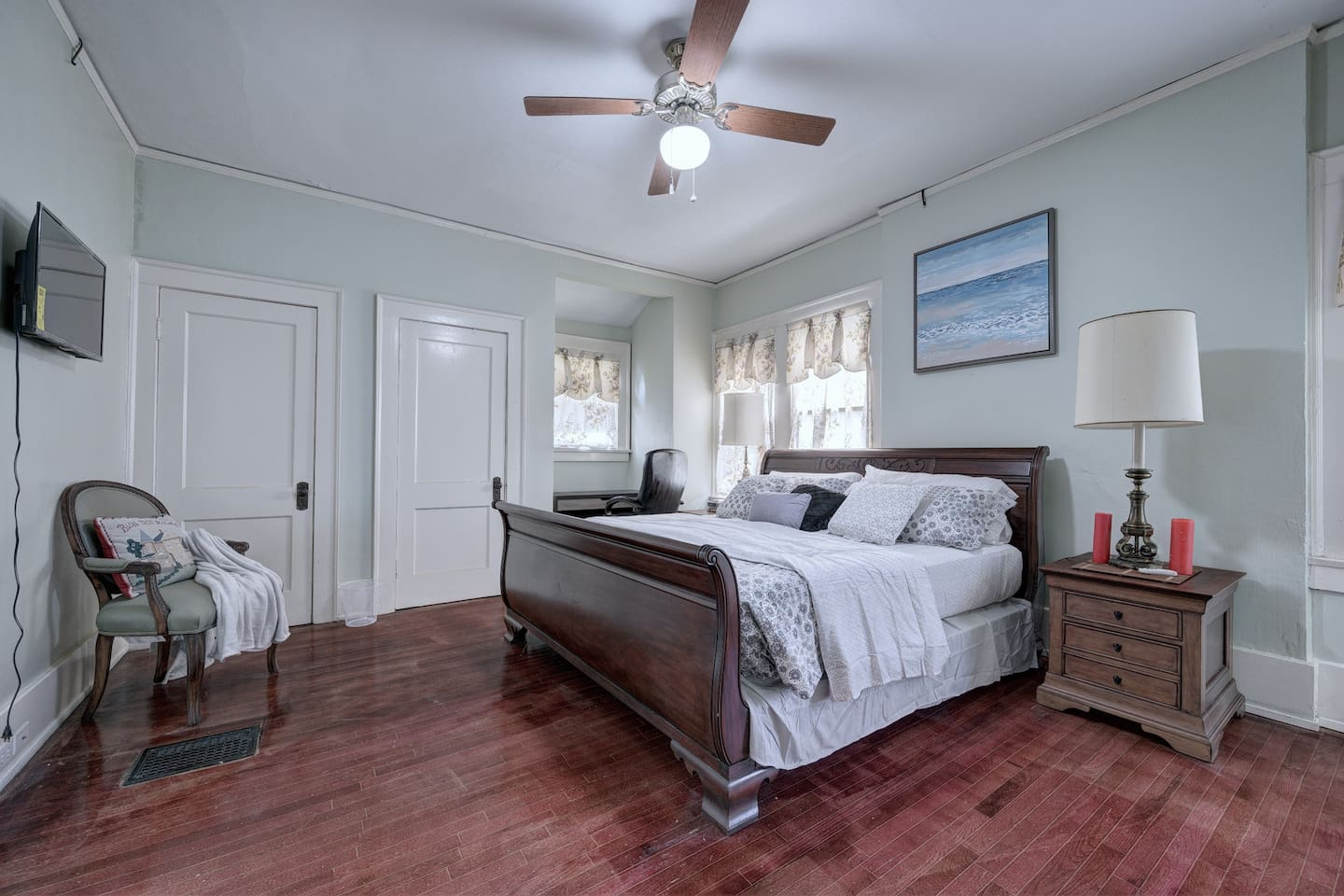 private king bedroom and private bathroom with shared kitchen space .