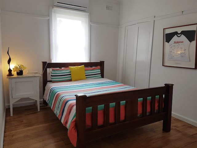 Bedroom 2. Queen size bed. New  comfortable mattress. Split system air conditioner. Electric Blanket. Polished floor boards. Quirky marble top bedside cupboard and separate 2 x 2 drawers. Sheets, blankets, doona and pillow cases all supplied.
