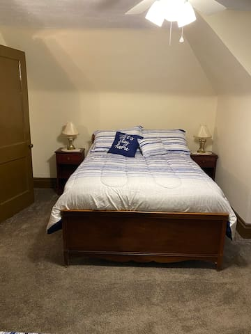 2nd bedroom with a full size bed and a twin bed.