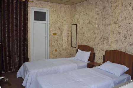 Twin beds, Air conditioned, Tv screen, fridge,Free  Wi-Fi