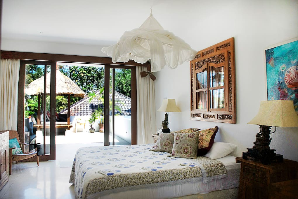 Your private room decorated with antiques along with private  terrace and cabana shrouded with bougainvillaea and trees