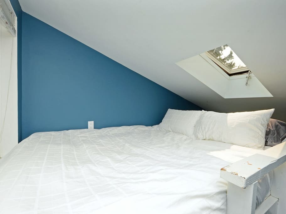 Loft bed - super comfortable and soft sheets.  Moon and the stars above you.