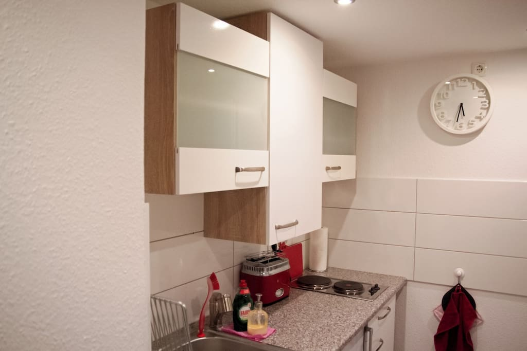 Well equipped modern kitchen with 2 ring hob, microwave, fridge, sink, and all the cooking and eating utensils you should need.