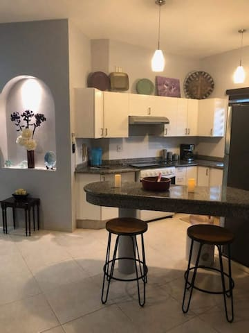 Lovely, fully equipped kitchen with new fidge, coffee maker, microwave, and everything you need to have a great time in our condo in Playacar!