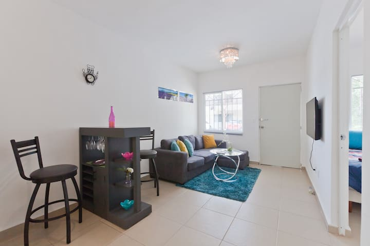 The very spacious and modern living room with Smart TV(Netflix included) & AC unit. The private parking spot is right in front.