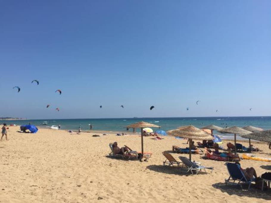 Halikounas beach has water sports and beach bars - kite surfing is popular when the wind is right