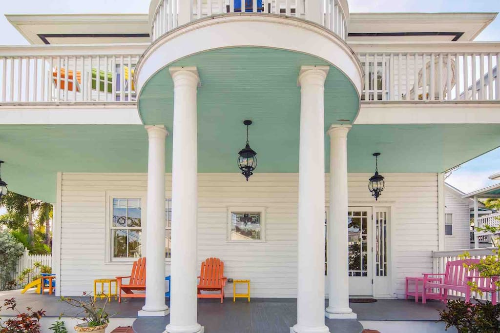 The large wrap-around front porch faces Duval Street...