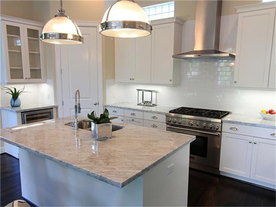 Kitchen Island with Thermador gas oven and stove