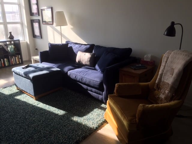 Our living room is funky, comfortable and spacious; it includes a queen sized sofa bed.