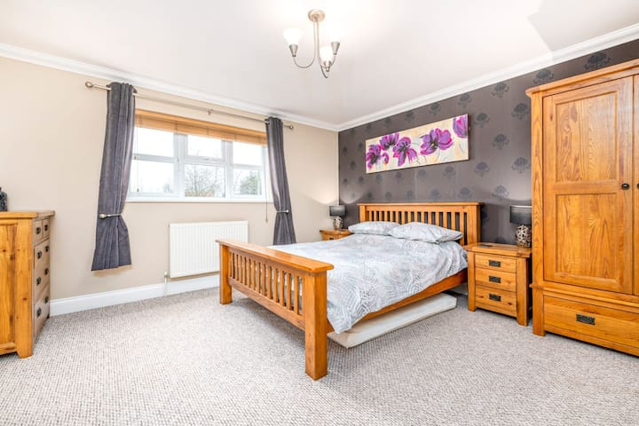 Master bedroom with ensuite, king bed and single bed.