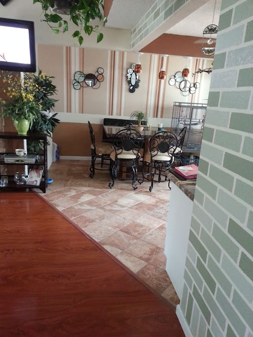 Dining room area.  New furniture, modern remodeled floors, doors, windows, and lighting.