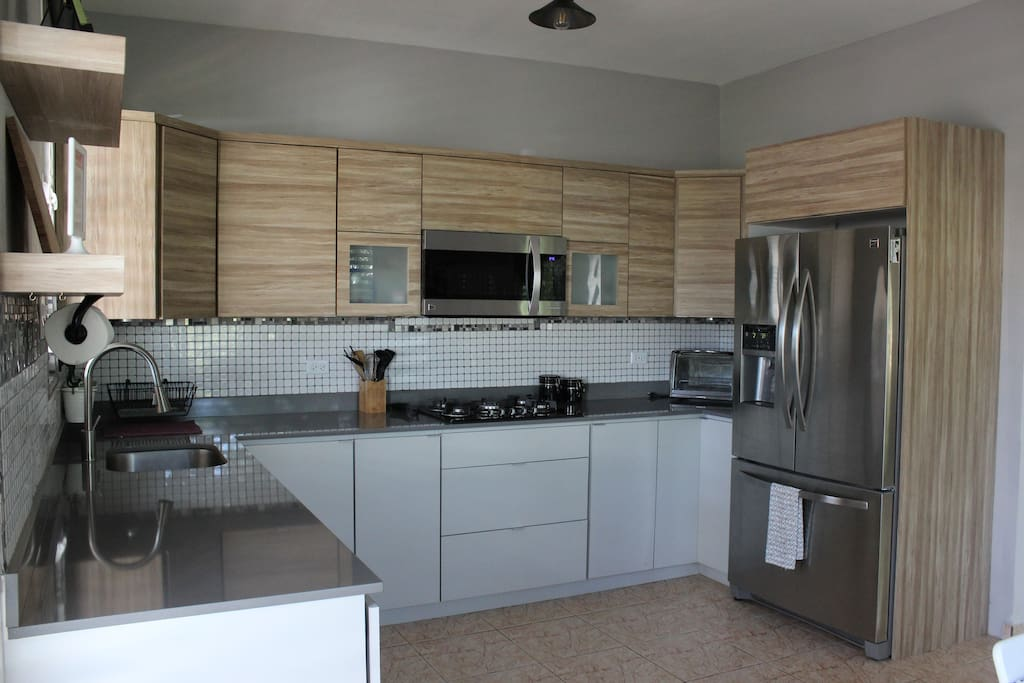 Fully equipped kitchen with gas stove, microwave/oven, dishwasher and full size fridge with ice and water filtration.