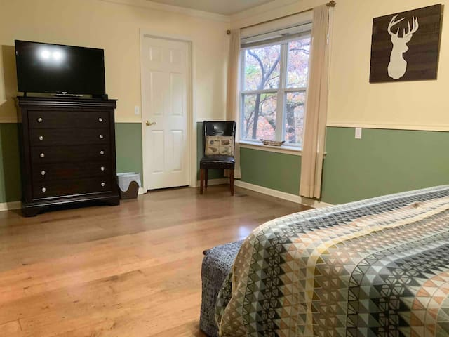 2nd bedroom: Master with king bed, TV, walk in closet, and attached bathroom.