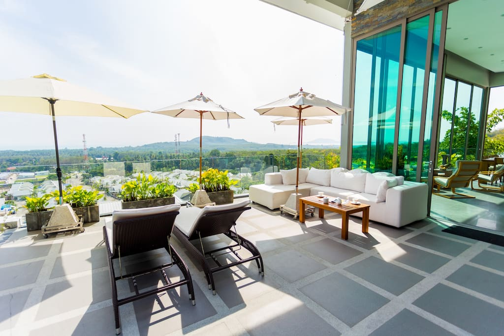 The Sunbrella outdoor sofa is the ideal place to relax