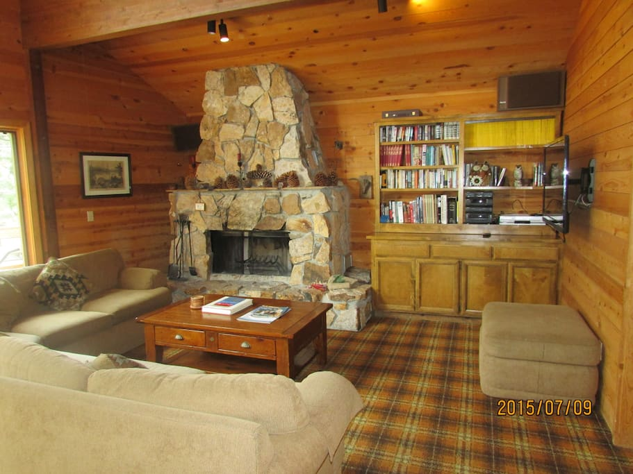 great room with big fireplace, soaring ceilings