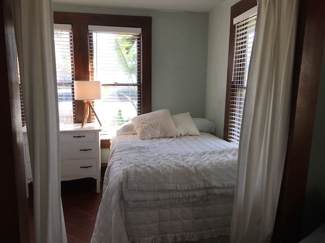 bedroom 2 (full bed) (if guests are also staying in attic space there is minimal privacy for this room as the 2 are separated by a spiral stair case... no real door to close between them though they are on separate floors).