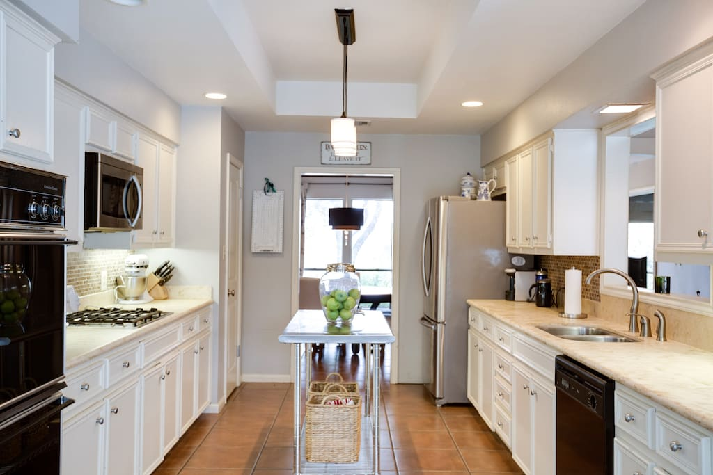 The kitchen connects to the dining room, the living room, and a reading nook that leads to the backyard. It really is the heart of the home.