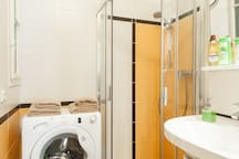 bathroom with washer & all towels and toilettries are provided including shampoos , shower gels etc.