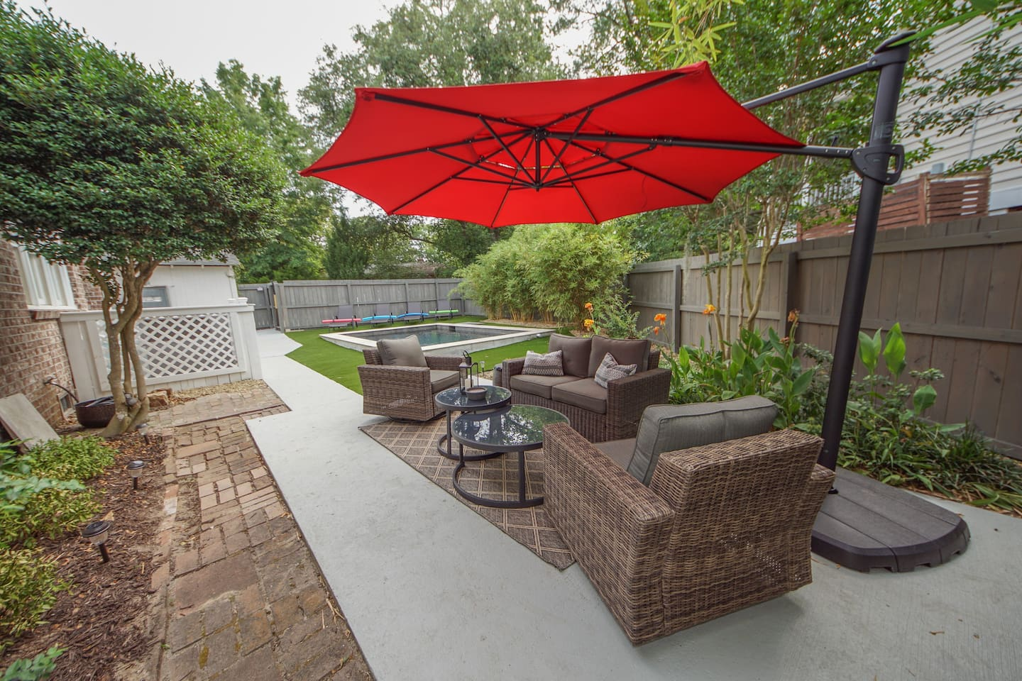 Great outdoor area with pool and tons of patio furniture