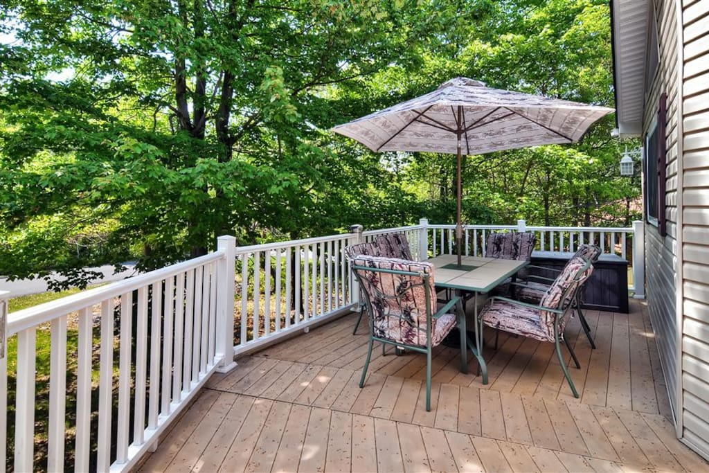 Spend time on the deck and enjoy the natural surroundings of the home.
