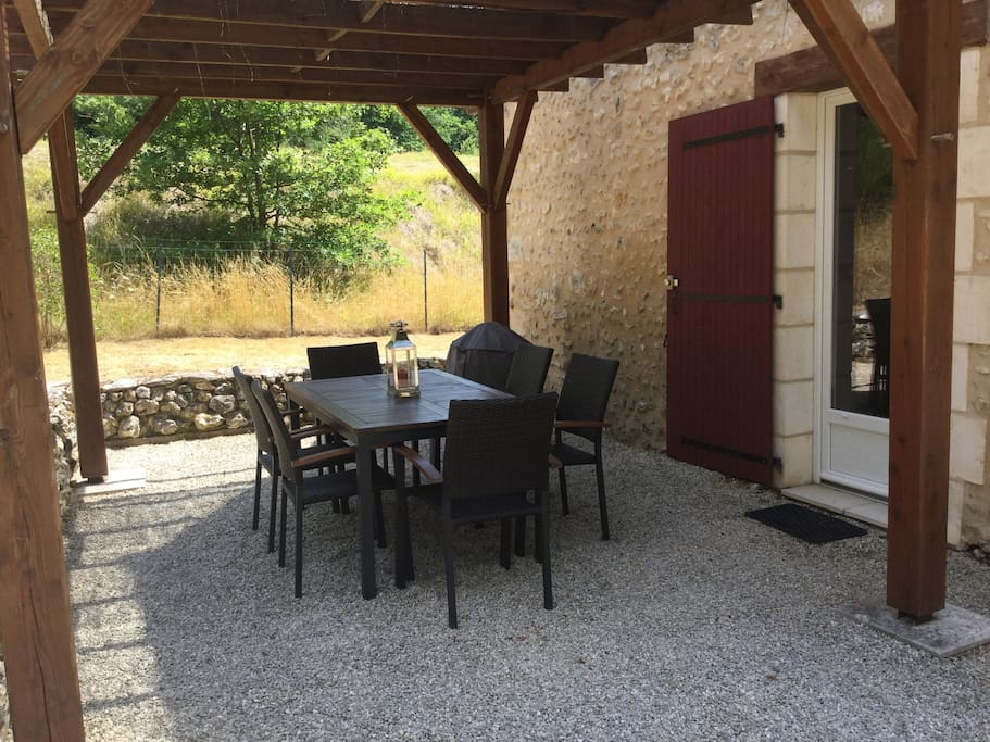 Shaded terrace area for dining al fresco, or just relaxing and enjoying your beverage of choice … Especially after a long tiring day of doing all of the sites! Weber Kettle BBQ. Separate convenient side door for easy access to and from the kitchen.