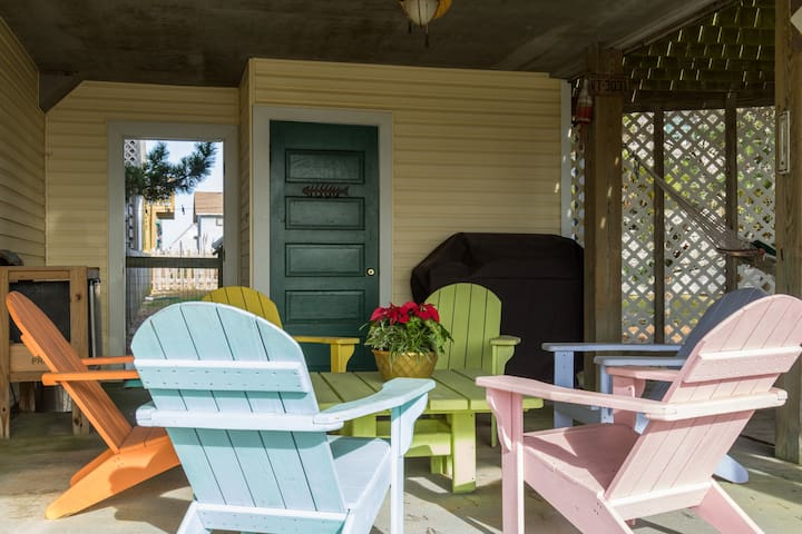 Outdoor covered patio with Adirondack chairs, grill, outdoor fridge, hammock, and hammock chair! Outdoor closet stores all of your beach accessories (chairs, buggy, & umbrella)!