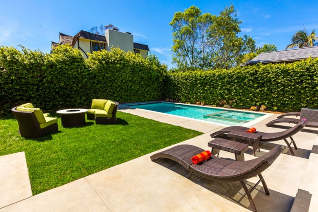 Private, serene Back Yard with new salt water pool and spa and built-in barbecue.