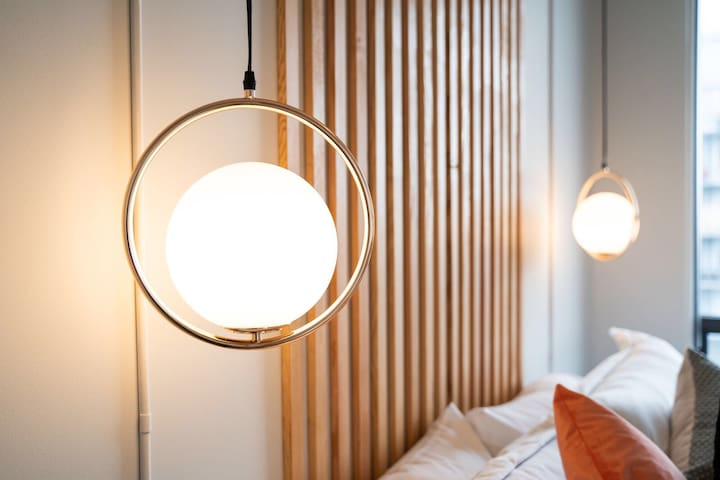 Set the right mood with dimmable hanging lights over the king-size bed