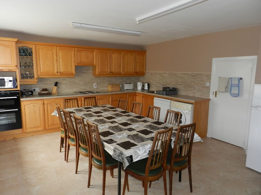 Kitchen with large table and seating for 12
