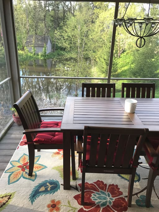 Screened in porch overlooking pond.