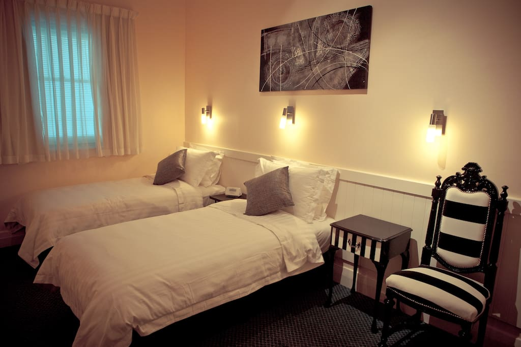 Bedroom 2: 2 large single beds with luxury bedding and furnishings.