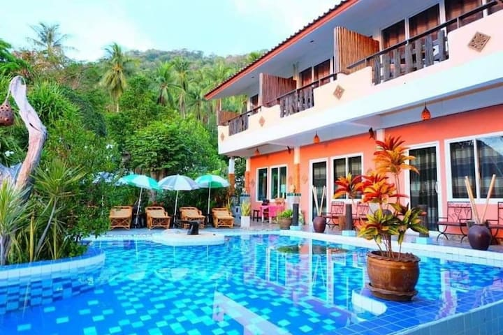 Luxury room in resort with large pool and sea view