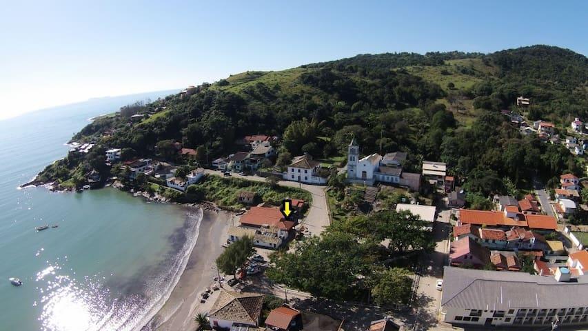 House by the sea, Garopaba's historic center
