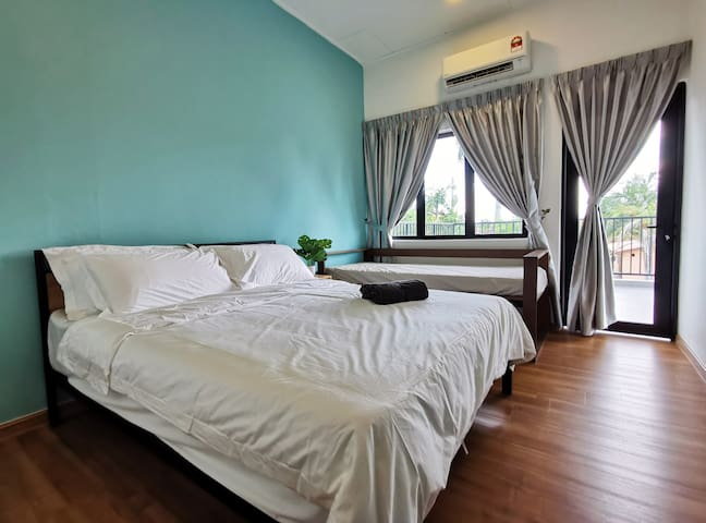 Interior of Room 4: 1 Queen Bed & 1 Single Bed