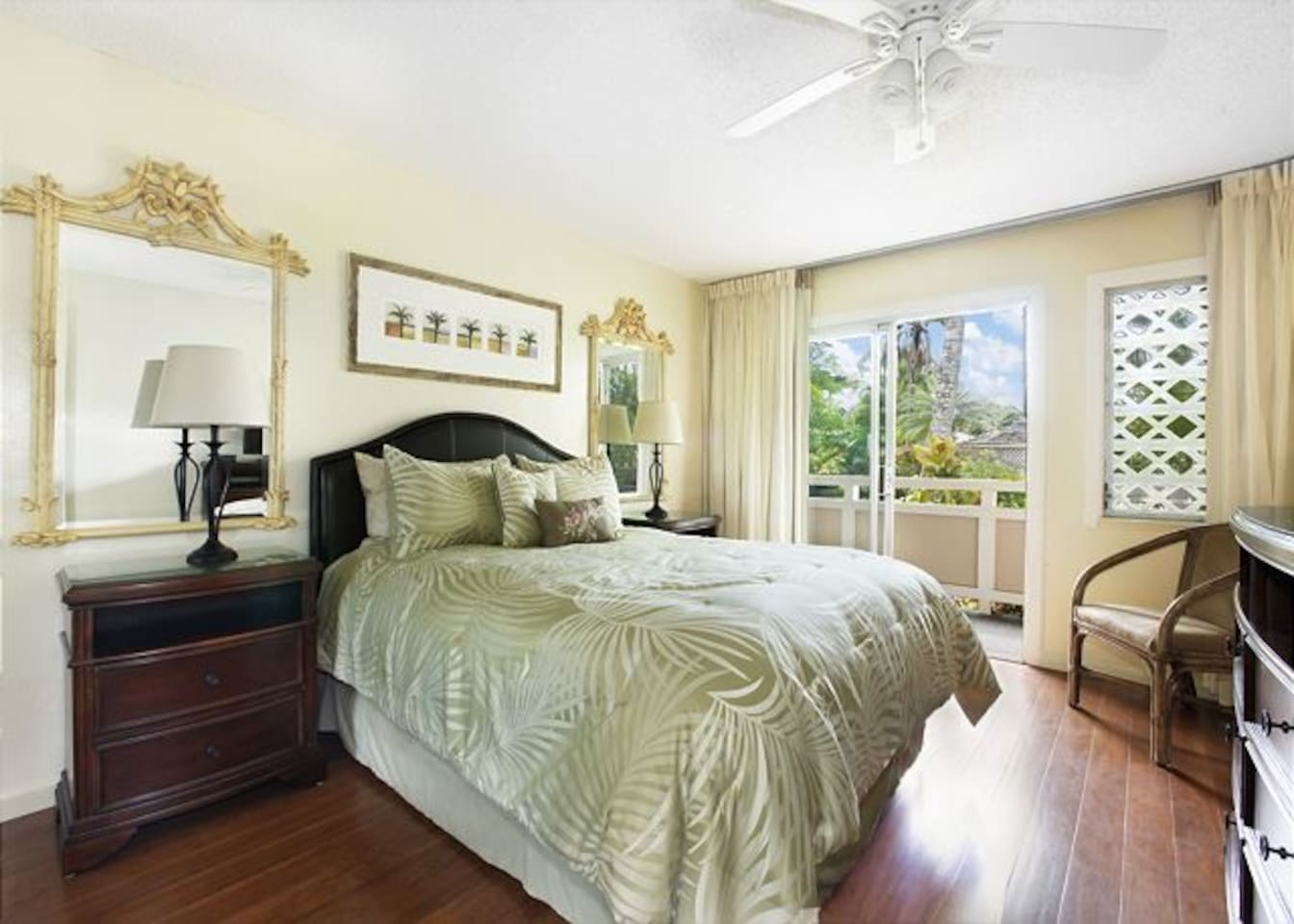 Inviting, spacious bright 'Aloha' style bedroom with queen bed, luxury, high thread count linens & glass sliders to lanai & pool/spa