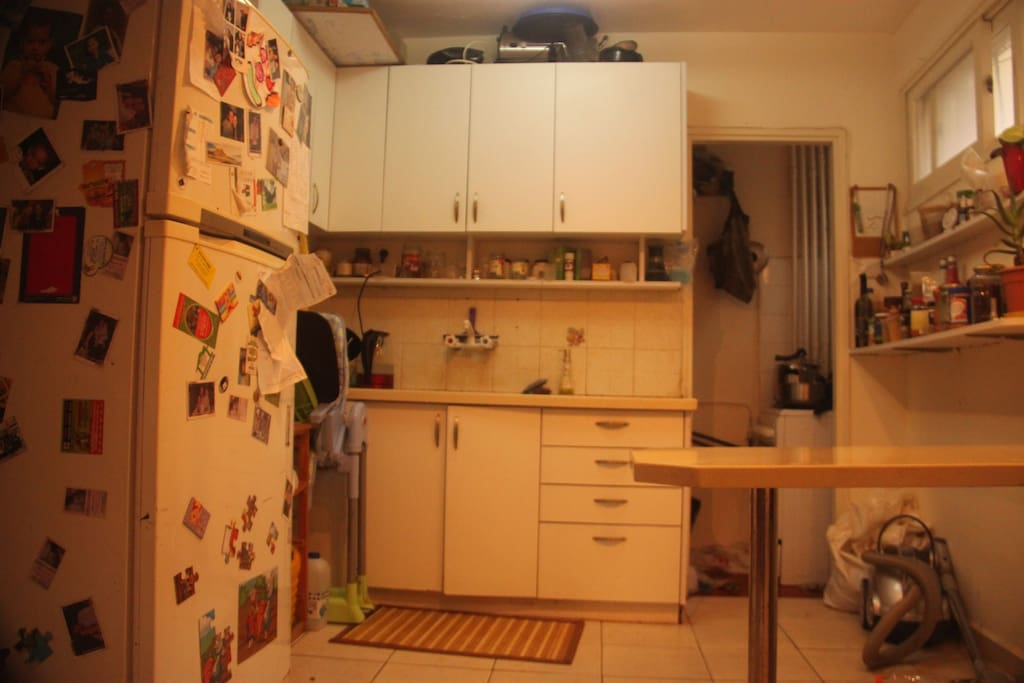 Cozy kitchen. YES you could use the fridge and eat whatever you find. Usually vegetables :)