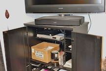 Large Screen TV with over 100 DVD / Videos available