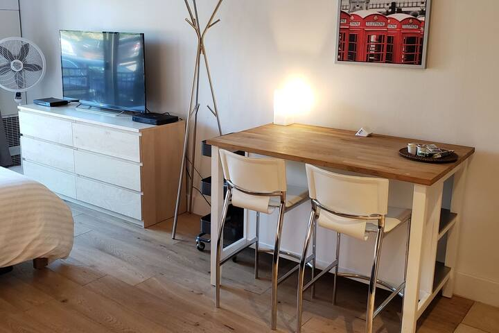 Eat and work at wood table with built in outlets and USB charging.